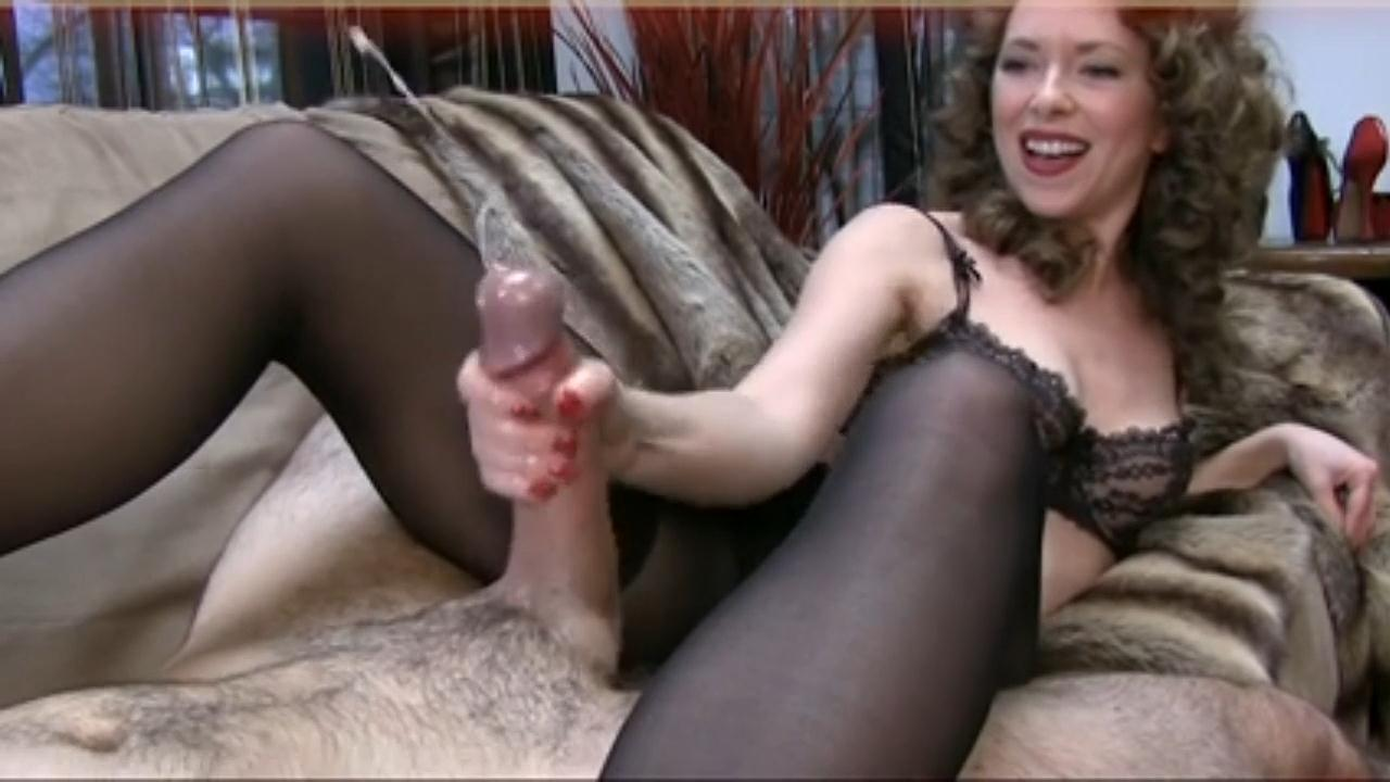 image Man masturbating in front of black dressed woman